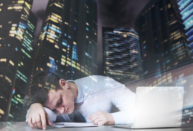 疲労困憊のビジネスマン